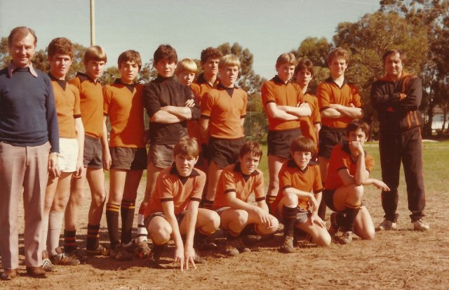 Team photo, Kevin is 3rd from Left, back row
